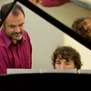 School of Music UCC classroom.  Alan Huckleberry works with students at the piano during his Piano Accompaniment class.
