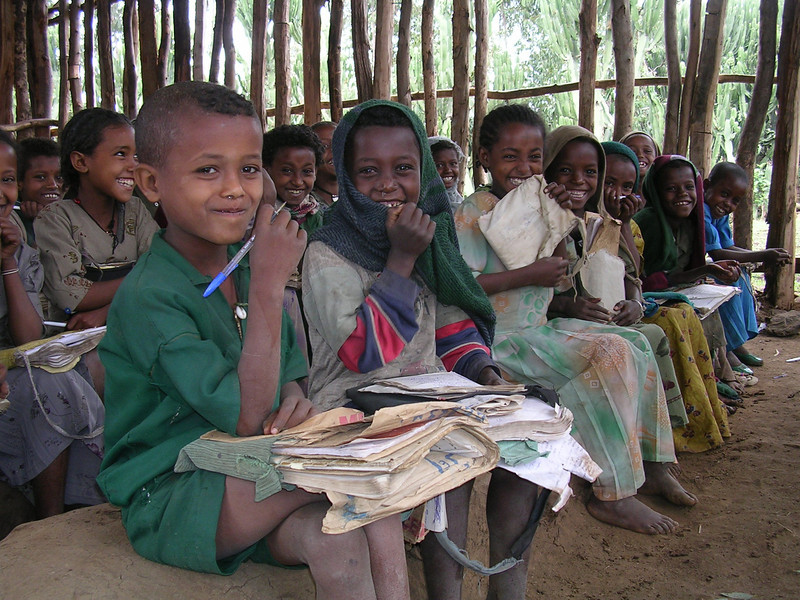 Happiness is  mud bench in a rural classroom