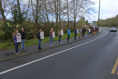 Shaun Walker — The Times-Standard  Coastal Grove Charter School students and several staff members stand along Alliance Road near their Arcata school Wednesday morning in silent remembrance of the latest Florida school shooting victims and calling for changes that will help prevent more similar events.Shaun Walker — The Times-Standard  Coastal Grove Charter School students and several staff members stand along Alliance Road near their Arcata school Wednesday morning in silent remembrance of the latest Florida school shooting victims and against teachers being armed.