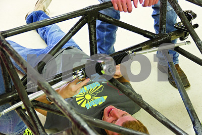 Photo by Shannon Wilson / Tyler Morning Telegraph Mack Stewart, a senior at Bullard High School, installs the rack and pinion steering parts to the solar car.