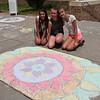 Nicole Didenko, Daelynn Riveron and Taylor Cotton design a flower mosaic during Pennridge Sidewalk Chalk Day. Debby High — For Montgomery Media