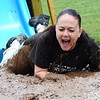 Principal Mia DiPaolo slides into the second annual Bedminster Mud Run Saturday, June 6. Debby High — For Montgomery Media