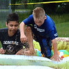 Brothers Darien and Brandon Rajan goes through the Pool Party challenge onto more hay bales. Debby High — For Montgomery Media