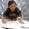 Giselle Yim slides down the slip and slid into soapy water to help clean the mud off. Debby High — For Montgomery Media