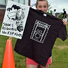 Third-grader Sierra Boyle gets herself ready for the second annual Bedminster Mud Run. Debby High — For Montgomery Media