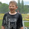 Noah Vanbeurden gets sprayed off after he completes the Bedminster Mud Run. Debby High — For Montgomery Media