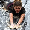 Ashley Godfrey concentrates on sliding down to get the mud off. Debby High — For Montgomery Media
