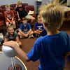 Dylan O'Donnell's hair stands up as she touches a Van Der Graff Generator with children conducting experiments in Physical Science & Eelectricity during the GSK Science in Summer event at the Perkasie Branch of the Free Library of Bucks County on Tuesday July 22,2014.Photo by Mark C Psoras/The Reporter