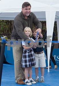 Stephen Thomas and his children Ransom, 4, and Roan, 6, cut the ribbon during the All Saints Episcopal School dedication ceremony for the school's new learning farm Tuesday Oct. 10, 2017 in Tyler, Texas. All Saints Episcopal School has the largest school learning farm in the state of Texas. It is located on their campus and allows students to learn about farming from planting and harvesting plants to caring for egg-laying hens.  (Sarah A. Miller/Tyler Morning Telegraph)