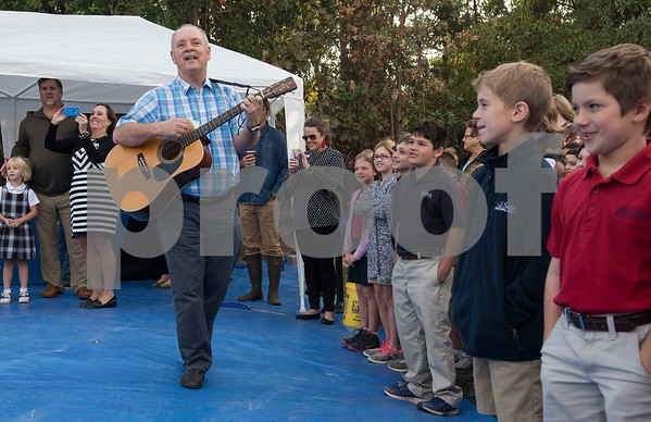 """All Saints Episcopal School music teacher Johnny Ray leads students in singing """"Old McDonald Had a Farm"""" during the dedication ceremony for the school's new learning farm Tuesday Oct. 10, 2017 in Tyler, Texas. All Saints Episcopal School has the largest school learning farm in the state of Texas. It is located on their campus and allows students to learn about farming from planting and harvesting plants to caring for egg-laying hens.  (Sarah A. Miller/Tyler Morning Telegraph)"""