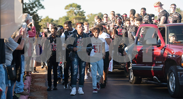 Robert E. Lee High School football players dress up during the Rock and Roll themed homecoming parade at the school Monday Oct. 16, 2017.   (Sarah A. Miller/Tyler Morning Telegraph)