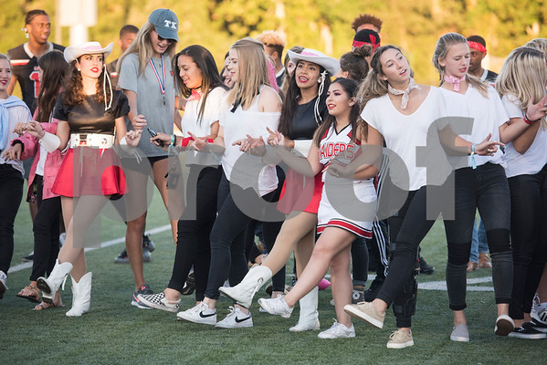 Robert E. Lee High School students from different clubs and sports organizations join arms to sing the school alma mater at the conclusion of the homecoming pep rally at the school Monday Oct. 16, 2017.   (Sarah A. Miller/Tyler Morning Telegraph)