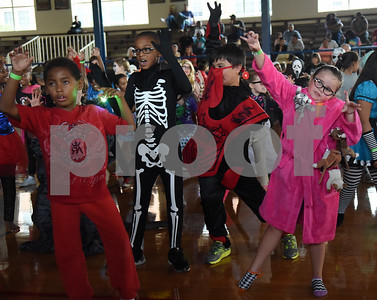 Betty Purslow, 7, dresses as a crazy cat lady as she dances with other students during the Sock Hop at Caldwell Elementary Arts Academy in Tyler Friday evening Oct. 21, 2016. The sock hop raised money to support the dance program which hosts a large dance showcase in the spring featuring every student in the school. Proceeds go toward costumes, building stage sets and other expenses.   (Sarah A. Miller/Tyler Morning Telegraph)