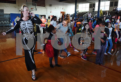 Teacher Dana Sepko leads a dance at the Sock Hop at Caldwell Elementary Arts Academy in Tyler Friday evening Oct. 21, 2016. The sock hop raised money to support the dance program which hosts a large dance showcase in the spring featuring every student in the school. Proceeds go toward costumes, building stage sets and other expenses.   (Sarah A. Miller/Tyler Morning Telegraph)