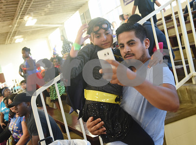 Francisco Pineda takes a selfie with Xitlally Pineda, 8, during the Sock Hop at Caldwell Elementary Arts Academy in Tyler Friday evening Oct. 21, 2016. The sock hop raised money to support the dance program which hosts a large dance showcase in the spring featuring every student in the school. Proceeds go toward costumes, building stage sets and other expenses.   (Sarah A. Miller/Tyler Morning Telegraph)