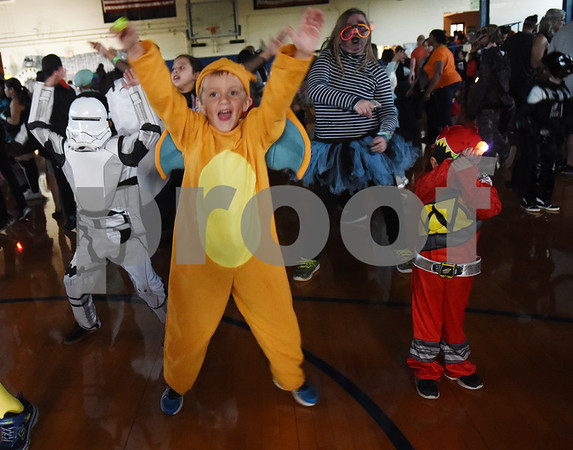 Drew Allen, 6, wears a Charizard Pokemon costume during the Sock Hop at Caldwell Elementary Arts Academy in Tyler Friday evening Oct. 21, 2016. The sock hop raised money to support the dance program which hosts a large dance showcase in the spring featuring every student in the school. Proceeds go toward costumes, building stage sets and other expenses.   (Sarah A. Miller/Tyler Morning Telegraph)