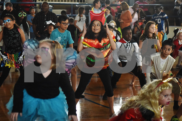 Selena Sosa, 9, dances while dressed in a cheeseburger costume during the Sock Hop at Caldwell Elementary Arts Academy in Tyler Friday evening Oct. 21, 2016. The sock hop raised money to support the dance program which hosts a large dance showcase in the spring featuring every student in the school. Proceeds go toward costumes, building stage sets and other expenses.   (Sarah A. Miller/Tyler Morning Telegraph)