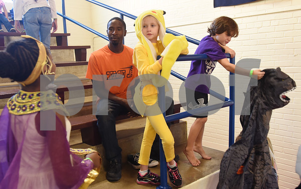 Abigail Francez, 7, dresses as Pikachu and Andrew Ames, 7, holds his dinosaur costume during the Sock Hop at Caldwell Elementary Arts Academy in Tyler Friday evening Oct. 21, 2016. The sock hop raised money to support the dance program which hosts a large dance showcase in the spring featuring every student in the school. Proceeds go toward costumes, building stage sets and other expenses.   (Sarah A. Miller/Tyler Morning Telegraph)