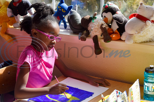 Emarie Lindsey, 6, paints during art class at Caldwell Arts Academy in Tyler, Texas, on Monday, Oct. 22, 2018. The students made paintings to go with donations to those affected by Hurricane Michael. (Chelsea Purgahn/Tyler Morning Telegraph)