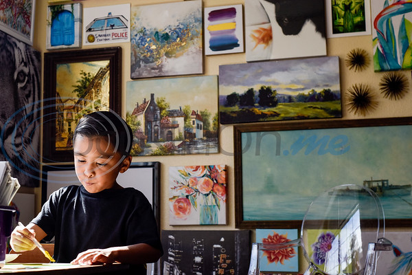 Daylan Arellano, 6, paints during art class at Caldwell Arts Academy in Tyler, Texas, on Monday, Oct. 22, 2018. The students made paintings to go with donations to those affected by Hurricane Michael. (Chelsea Purgahn/Tyler Morning Telegraph)