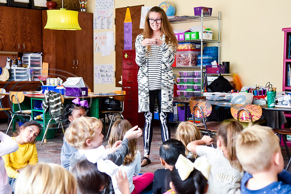 Teacher Nikki Aubuchon speaks to her students during art class at Caldwell Arts Academy in Tyler, Texas, on Monday, Oct. 22, 2018. The students made paintings to go with donations to those affected by Hurricane Michael. (Chelsea Purgahn/Tyler Morning Telegraph)