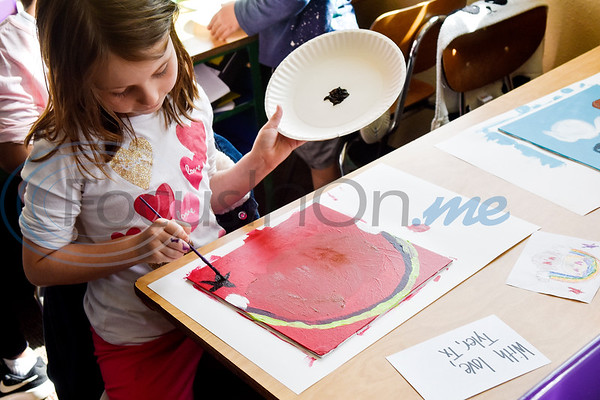 Lily Brashear, 7, paints during art class at Caldwell Arts Academy in Tyler, Texas, on Monday, Oct. 22, 2018. The students made paintings to go with donations to those affected by Hurricane Michael. (Chelsea Purgahn/Tyler Morning Telegraph)