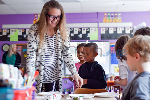 Teacher Nikki Aubuchon helps students pick out paint colors during art class at Caldwell Arts Academy in Tyler, Texas, on Monday, Oct. 22, 2018. The students made paintings to go with donations to those affected by Hurricane Michael. (Chelsea Purgahn/Tyler Morning Telegraph)