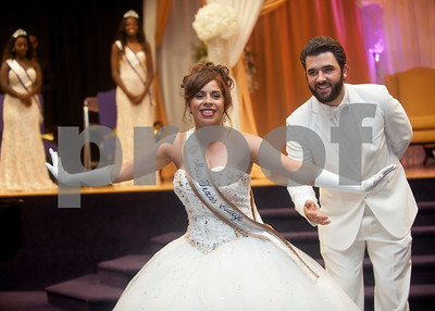Texas College student Paloma Bermudez bows to the audience with escort Juan Mesa during her Miss Texas College coronation ceremony at Martin Hall auditorium. The event was part of the week's homecoming activities.   (Sarah A. Miller/Tyler Morning Telegraph)