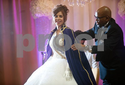 Texas College president Dr. Dwight Fennell places a robe over student Paloma Bermudez as she's crowned Miss Texas College Friday during a coronation ceremony at Martin Hall auditorium. The event was part of the week's homecoming activities.   (Sarah A. Miller/Tyler Morning Telegraph)