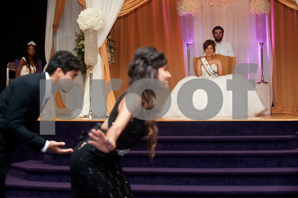 Mr. and Miss Soccer Eduardo Vargas and Karina Martinez bow for Miss Texas College Paloma Bermudez and escort Juan Mesa during the Miss Texas College coronation ceremony at Martin Hall auditorium. The event was part of the week's homecoming activities.   (Sarah A. Miller/Tyler Morning Telegraph)