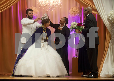 Texas College student Paloma Bermudez is crowned Miss Texas College Friday during a coronation ceremony at Martin Hall auditorium. She is assisted with her crown by escort Juan Mesa, left, and Texas College president and first lady Dr. Dwight Fennell and Angelia Fennell. The event was part of the week's homecoming activities.   (Sarah A. Miller/Tyler Morning Telegraph)