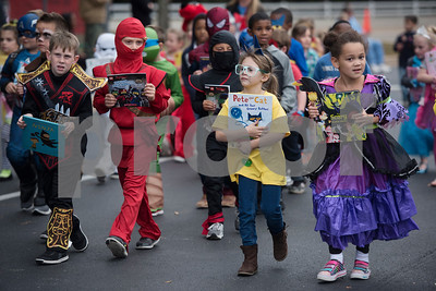 Owens Elementary School students dress up as characters from children's books and carry their books with them during a parade at the school on Halloween Tuesday Oct. 31, 2017.  (Sarah A. Miller/Tyler Morning Telegraph)