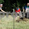Clayton Bell, Chelsea Dingler, Hope Bell and Colton Miller take down a fence on the property.