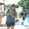 Jessica Monzon helps take out the trash.