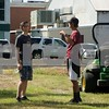 Cole Craig (r)  and Nathan Grounds (l) discuss mowing.