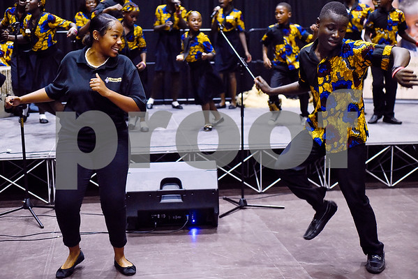 A Texas College Concert Choir member dances with the Parental Care Ministries Uganda Choir as they perform during Texas College Homecoming Week at Gus F. Taylor Auditorium at Texas College in Tyler, Texas, on Wednesday, Oct. 4, 2017. The choir is currently on a six-week tour throughout the United States. (Chelsea Purgahn/Tyler Morning Telegraph)
