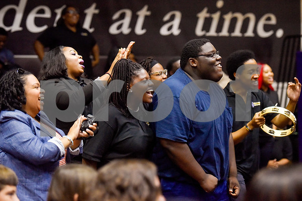 Audience members cheer as the Parental Care Ministries Uganda Choir performs during Texas College Homecoming Week at Gus F. Taylor Auditorium at Texas College in Tyler, Texas, on Wednesday, Oct. 4, 2017. The choir is currently on a six-week tour throughout the United States. (Chelsea Purgahn/Tyler Morning Telegraph)