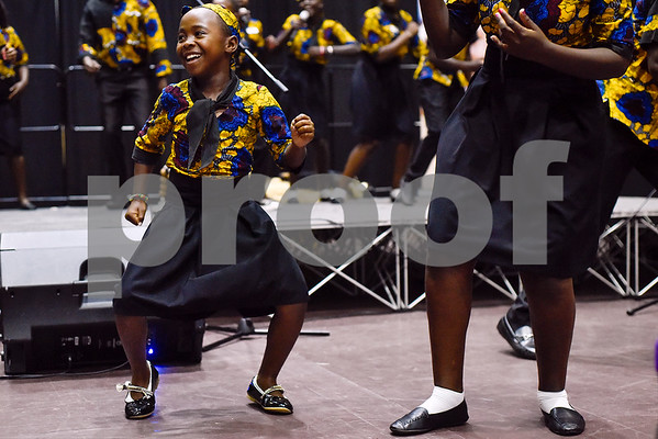 The Parental Care Ministries Uganda Choir performs during Texas College Homecoming Week at Gus F. Taylor Auditorium at Texas College in Tyler, Texas, on Wednesday, Oct. 4, 2017. The choir is currently on a six-week tour throughout the United States. (Chelsea Purgahn/Tyler Morning Telegraph)