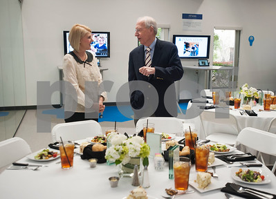 Debra Cobb, wife of Head of School Mike Cobb, speaks with donor Jeff Buford during the All Saints Episcopal School donor luncheon held at the school on Wednesday Jan. 10, 2018.  (Sarah A. Miller/Tyler Morning Telegraph)