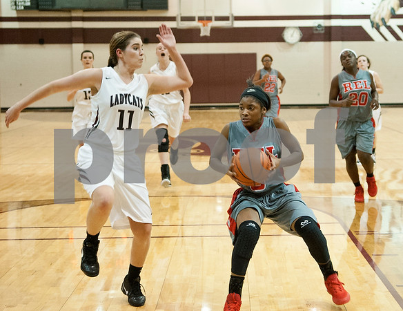 Whitehouse's (11) Callier Vee and Robert E. Lee's (5) Kinsey Whitman race to the basket Tuesday night at Whitehouse High School during the girls basketball season opener.  (Sarah A. Miller/Tyler Morning Telegraph)