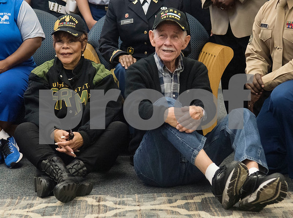 Veterans Dr. Shirley J. McKellar and Jim Armstrong pose for a group photo at the conclusion of the first ever Veterans Day breakfast event held at John Tyler High School by the Lion Battalion JROTC Friday Nov. 10, 2017.  (Sarah A. Miller/Tyler Morning Telegraph)