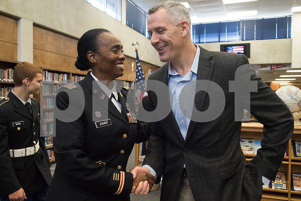 Lt. Col. Janie Eddins, John Tyler JROTC instructor, shakes hands with Texas Rep. Matt Schaefer, a Lieutenant Commander in the U.S. Navy Reserve, during the first ever Veterans Day breakfast event held at John Tyler High School by the Lion Battalion JROTC Friday Nov. 10, 2017.  (Sarah A. Miller/Tyler Morning Telegraph)
