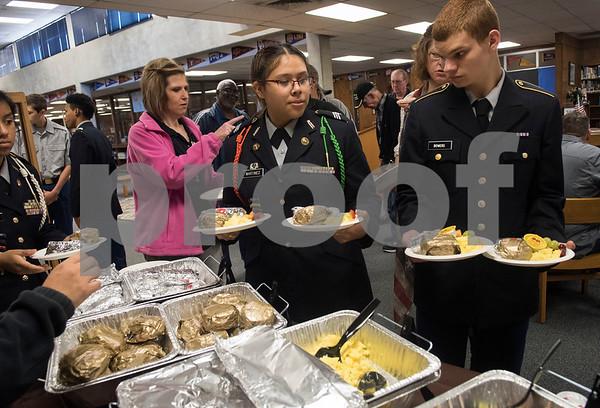 John Tyler JROTC students Joana Martinez and John Bowers make breakfast plates for veterans attending the first ever Veterans Day breakfast event held at John Tyler High School by the Lion Battalion JROTC Friday Nov. 10, 2017.  (Sarah A. Miller/Tyler Morning Telegraph)