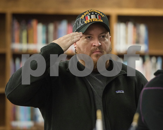 Veteran Dan Cole salutes as the colors are presented during the first ever Veterans Day breakfast event held at John Tyler High School by the Lion Battalion JROTC Friday Nov. 10, 2017.  (Sarah A. Miller/Tyler Morning Telegraph)