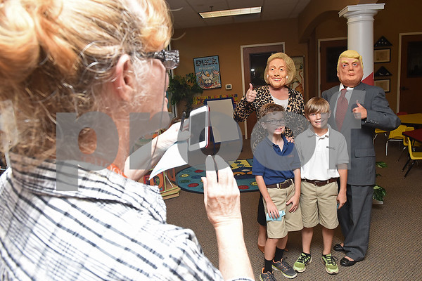 Teacher Judy Brown takes a photo of students Blake Whitten and Jonathan Skinner with Hillary Clinton and Donald Trump during a mock election to help students learn about the process at The Brook Hill Lower School in Bullard Tuesday Nov. 1, 2016.  (Sarah A. Miller/Tyler Morning Telegraph)