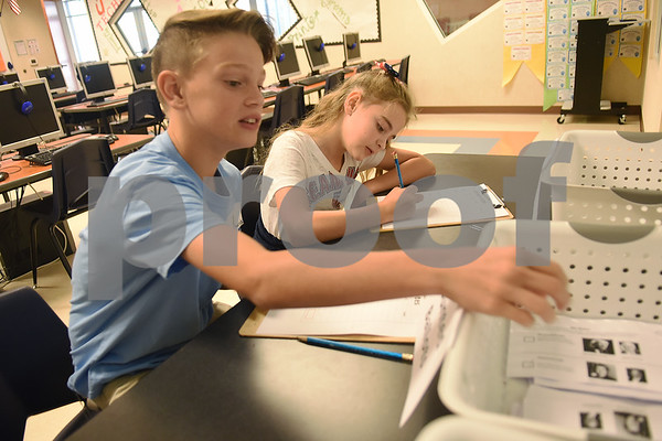 Fifth graders Colton Richards and Gemma Lake tabulate votes during the mock election to help students learn about the process at The Brook Hill Lower School in Bullard Tuesday Nov. 1, 2016.  (Sarah A. Miller/Tyler Morning Telegraph)