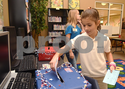 Third grader Analiese Barney submits her vote during the mock election to help students learn about the process at The Brook Hill Lower School in Bullard Tuesday Nov. 1, 2016.  (Sarah A. Miller/Tyler Morning Telegraph)