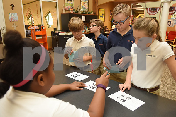 Third graders pick up their ballots during the mock election to help students learn about the process at The Brook Hill Lower School in Bullard Tuesday Nov. 1, 2016.  (Sarah A. Miller/Tyler Morning Telegraph)