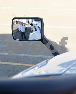 "David Bean, a professional truck driver for Walmart, is seen in the driver's side mirror of a semi truck during the  youth transportation safety program called ""Teens and Trucks – Helping Teens Drive Safer Around Large Commercial Motor Vehicles"" at Bullard High School Tuesday Nov. 1, 2016. The event was a partnership between the Texas Department of Safety, East Texas Council of Trucking Professionals, Texas A&M Transportation Safety Institute, and Bullard Independent School District to educate students on sharing the road with commercial motor vehicles.  (Sarah A. Miller/Tyler Morning Telegraph)"