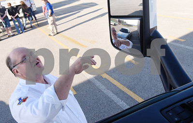 "David Bean, a professional truck driver for Walmart, explains what can and cannot be seen in the driver's side mirror of a semi truck during the  youth transportation safety program called ""Teens and Trucks – Helping Teens Drive Safer Around Large Commercial Motor Vehicles"" at Bullard High School Tuesday Nov. 1, 2016. The event was a partnership between the Texas Department of Safety, East Texas Council of Trucking Professionals, Texas A&M Transportation Safety Institute, and Bullard Independent School District to educate students on sharing the road with commercial motor vehicles.  (Sarah A. Miller/Tyler Morning Telegraph)"
